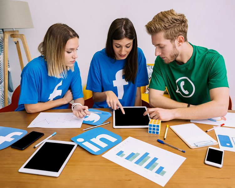 team-social-media-networking-looking-digital-tablet-office (1)